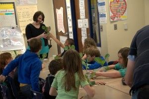 teacher with kids and cabbages in classroom